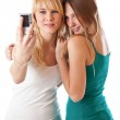 Two teenage girls photographing on — Stock Photo
