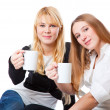 Two teenage girls is drinking tea — Stock Photo