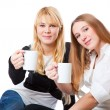 Royalty-Free Stock Photo: Two teenage girls is drinking tea
