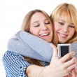 Royalty-Free Stock Photo: Two teenage girls photographing on