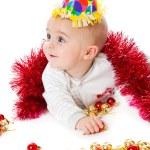 Little boy wearing a Santa hat and playi — Stock Photo #1284681