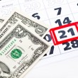 Royalty-Free Stock Photo: Dollar bills on calendar