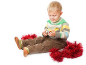 Little boy and tinsel — Stok fotoğraf