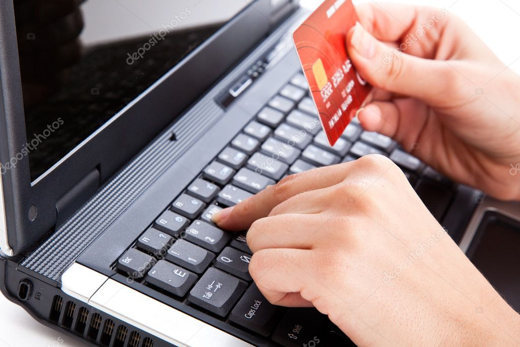 Credit card in hand for buying online — Stock Photo #1288090