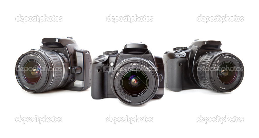 Modern digital camera. Isolated on white background — Stok fotoğraf #1289088
