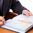 Businessman is looking on map — Stockfoto