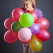Young girl holding balloons — Stock Photo #2236369
