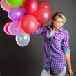 Young girl holding balloons - Stock Photo