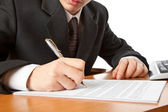 Businessman hands signing a contract. — Stock Photo
