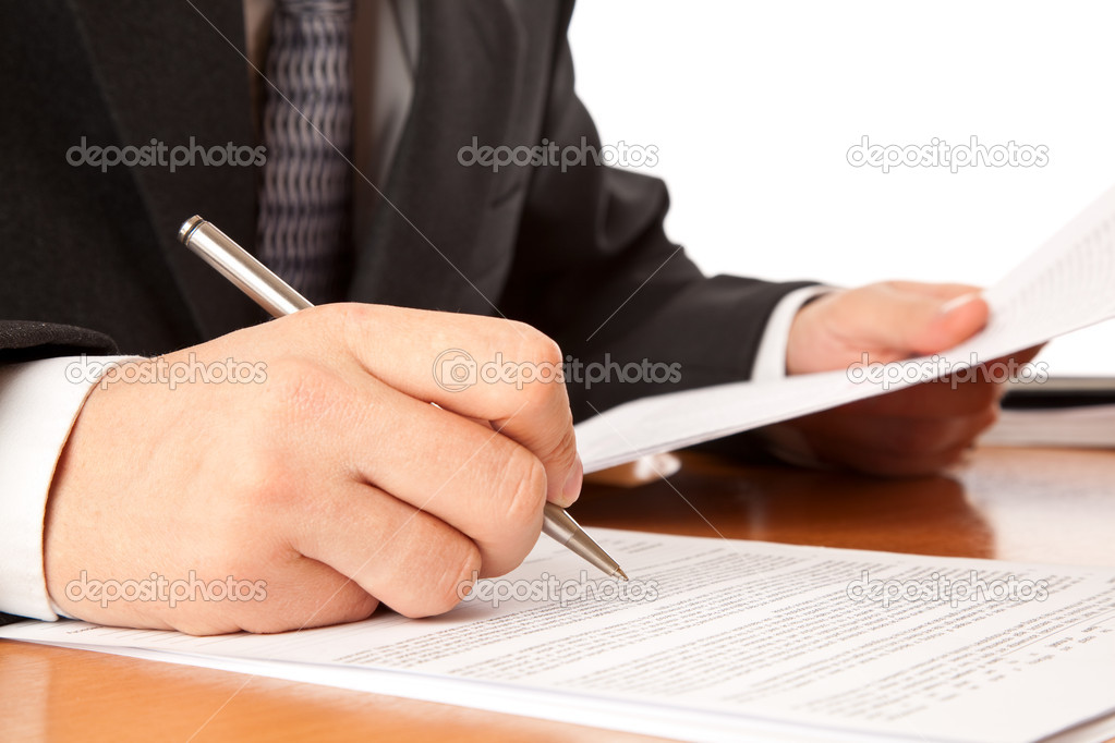 Close up on a businessman hands signing a contract. Isolated on white background — Stock Photo #2234619