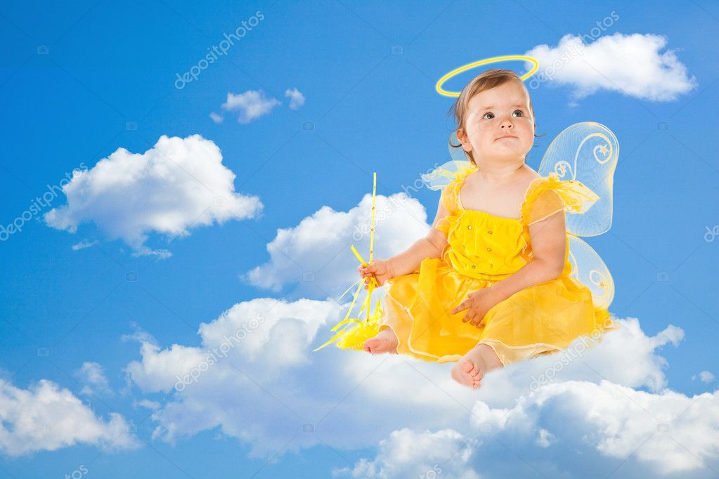 Little fairy in yellow dress on clouds — Stock Photo #2236179