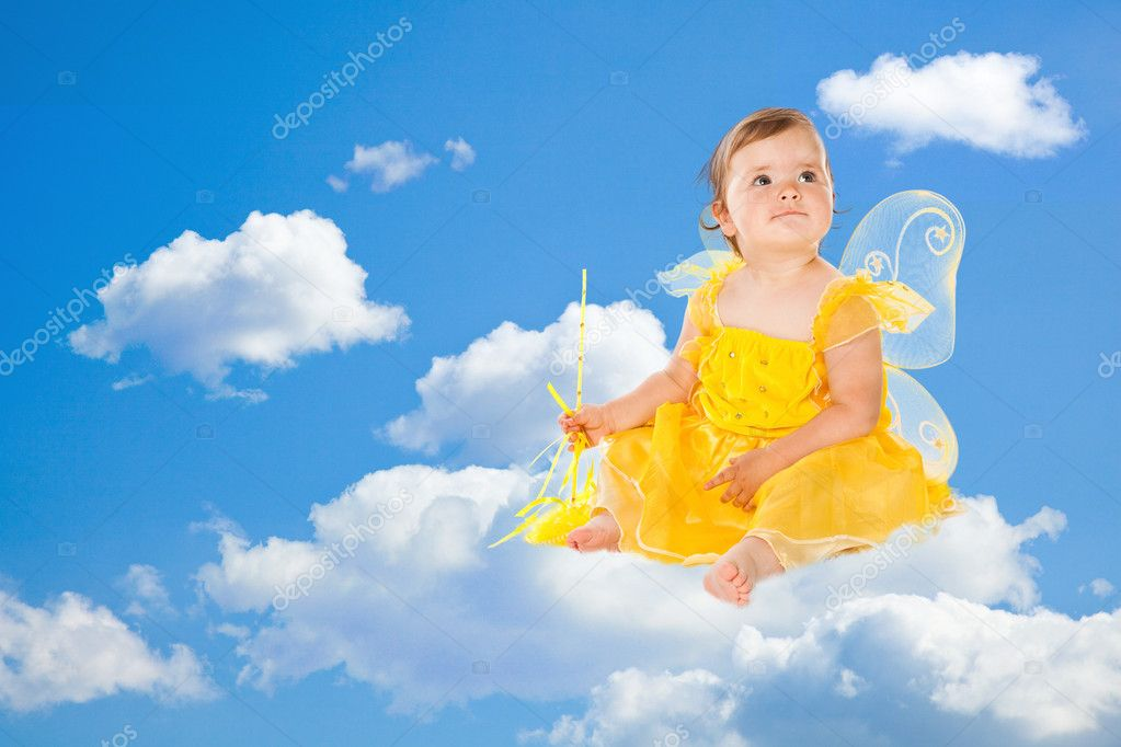 Little fairy in yellow dress on clouds  Stock Photo #2236202