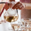 Woman is pouring green tea in cups — Stock Photo #2249387