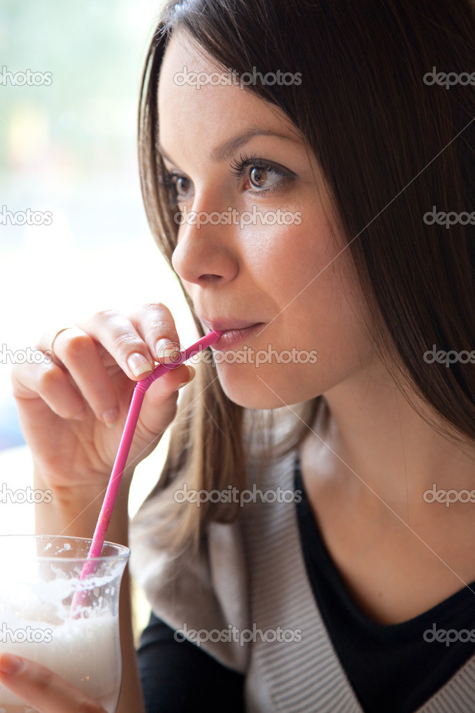 Young girl is drinking cocktail in cafe — Stock Photo #2249355
