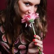 Woman sniffing a flower — Stock Photo