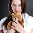 Pretty model with toy bear — Stock Photo #1168094