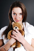 Pretty model with toy bear — Stock Photo