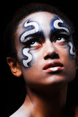 Portrait of mulatto girl with face-art — Stock Photo
