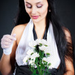Woman with a chrysanthemum — Stock Photo