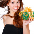 Smiling woman with a gift - Stok fotoğraf