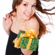 Stock Photo: Smiling womwith gift