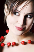Poratrait of woman with beads — Stock Photo