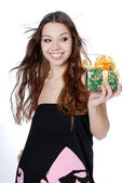 Smiling woman with a gift — Stock Photo