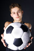Man with soccer ball. Focus on ball. — Stock Photo