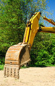 Yellow backhoe — Stock Photo
