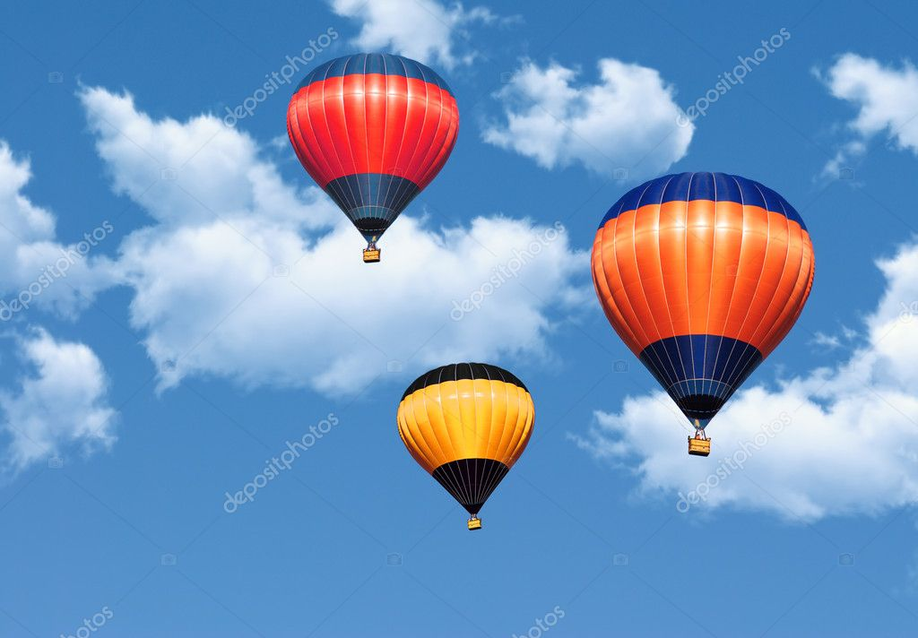 Colorful hot air balloons in the blue sky covered by clouds  Photo #1195909