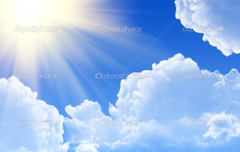 Sunny rays in blue sky  Stock Photo #1218432