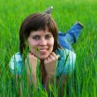Girl, lying on grass - Stock Photo