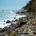 Coastline near the rocks — Stock Photo