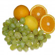 Royalty-Free Stock Photo: Fruits grapes, oranges and a lemon