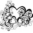 Heart with floral ornament, vector — Stockvectorbeeld