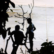 Stock Photo: Boys playing at Mekong river
