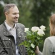 Man gives flowers woman — Stock Photo