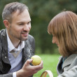 Romantic couple by picnic - Stock Photo