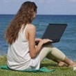 Royalty-Free Stock Photo: Woman with laptop on the beach