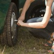 Stock Photo: Change tire