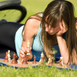 Woman playing chess — Stock Photo