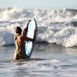 Stock Photo: Boogie boarding on sunset
