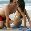 Couple kissing at the beach - Lizenzfreies Foto