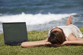 Woman sunbathing on grass — Stock Photo