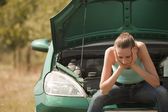Sad woman with broken car — Stock Photo