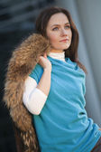 Fashion woman with fur coat — Stock Photo
