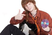 Musician with guitar selling compact dis — Stock Photo