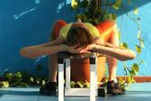 Stretching at the bench — Stock Photo