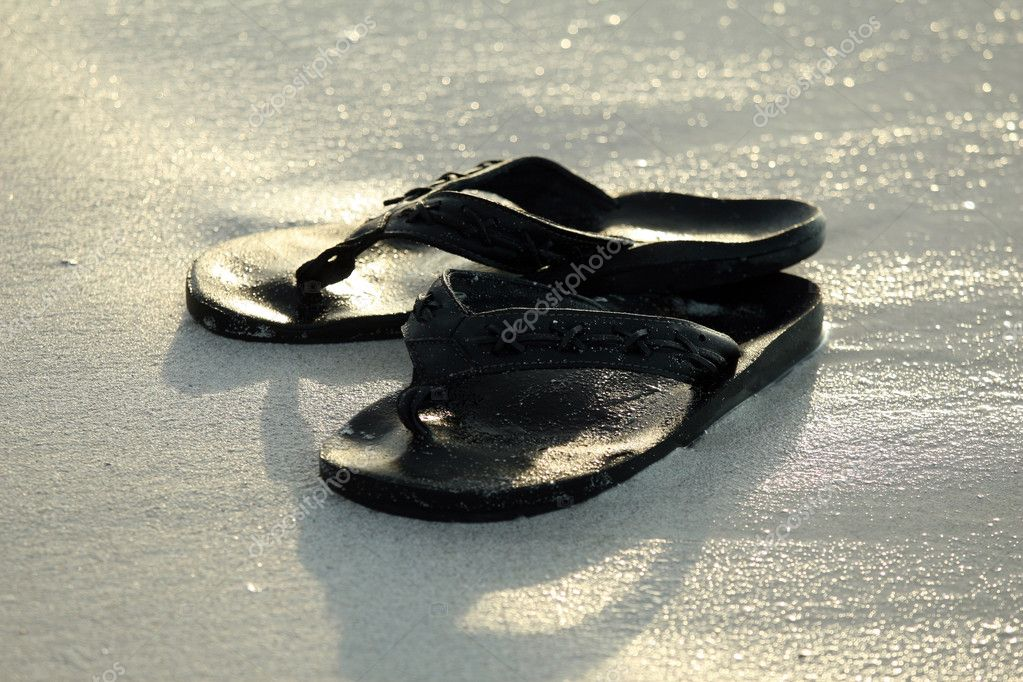 A pair of flip flops on beach — Stock Photo #1178277
