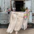 Clothes dried on balcony - Stock Photo